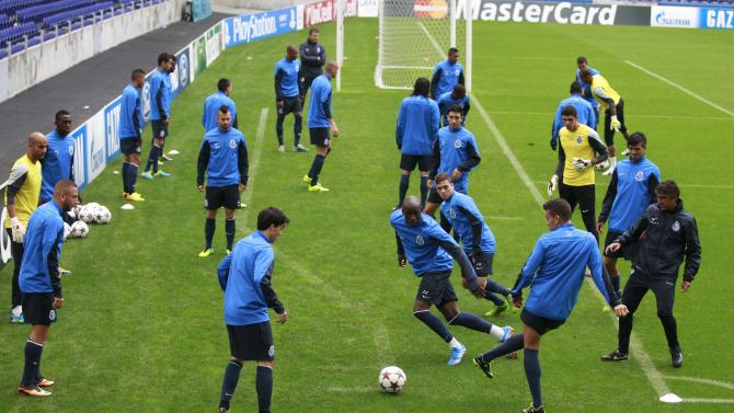 Porto's players warm up for their training session at Dragon stadium in Porto