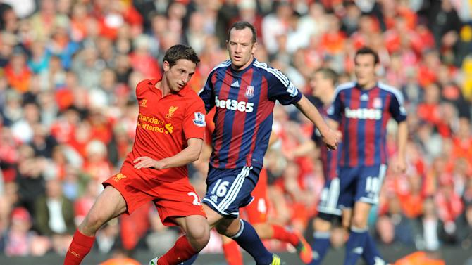 Charlie Adam, right, and Stoke secured a point on the Scotsman's return to Anfield