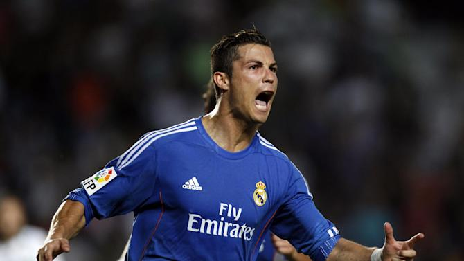 Real Madrid's Cristiano Ronaldo from Portugal celebrates after scoring against Elche during their La Liga soccer match at the Martinez Valero stadium in Elche, Spain, Wednesday, Sept. 25, 2013