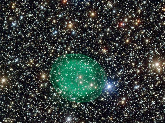 This photo shows the glowing green planetary nebula IC 1295 surrounding a dim and dying star. It is located about 3300 light-years away from Earth.