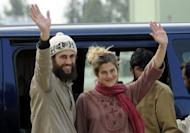 Swiss couple Olivier David Och and Daniela Widmer arrive at the Qasim base in Rawalpindi, Pakistan on March 15. The Swiss couple held captive by the Pakistani Taliban for over eight months were flown back to the capital on Thursday, smiling and waving to the cameras and apparently in good health