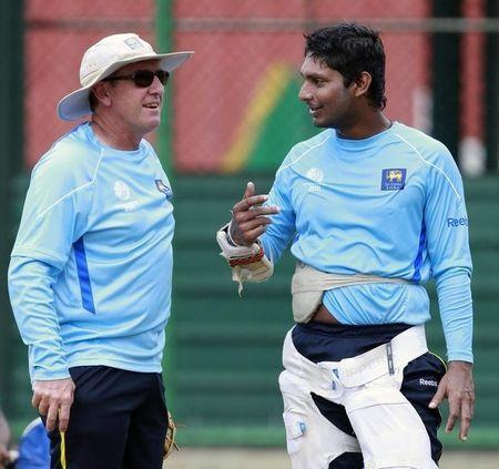 Sri Lanka's captain Sangakkar speaks with coach Bayliss during a practice session ahead of their ICC Cricket World Cup match against Kenya, in Colombo