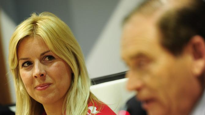 Formula One team Marussia driver  Maria De Villota of Spain looks to Auto Spanish Federation President Carlos Gracia during a press conference in Madrid on March 9, 2012.  AFP PHOTO/JAVIER SORIANO. (Photo credit should read JAVIER SORIANO/AFP/Getty Images)
