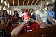 Supporters of Venezuelan President Hugo Chavez pray at the chapel inside the Military Hospital in Caracas, March 5, 2013. Venezuela has plunged deeper into an uncertain future after the cancer-stricken president took a turn for the worse, hit by a severe infection and breathing problems