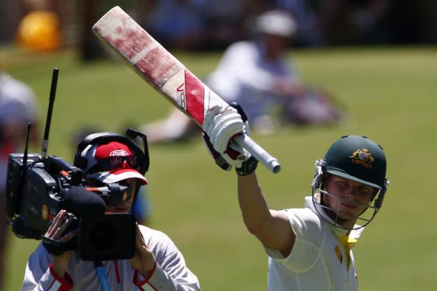 Australia's Smith raises his bat to the crowd as he walks off the field after his dismissal by England's Anderson during the second day of the third Ashes test cricket match in Perth
