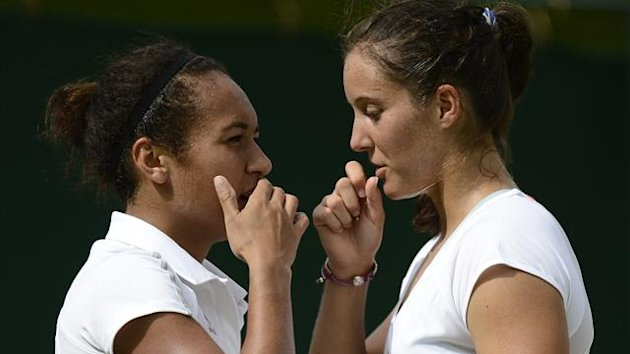 Heather Watson of Britain (L) and her partner Laura Robson of Britai