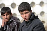 """Afghan actors Jawanmard Paiz (R) and Fawad Mohammadi during an interview with AFP in Kabul on February 9, 2013. Both star in """"Buzkashi Boys"""", a film about two youngsters growing up in Kabul who dream of becoming Buzkashi horseback riders in Afghanistan's national sport"""