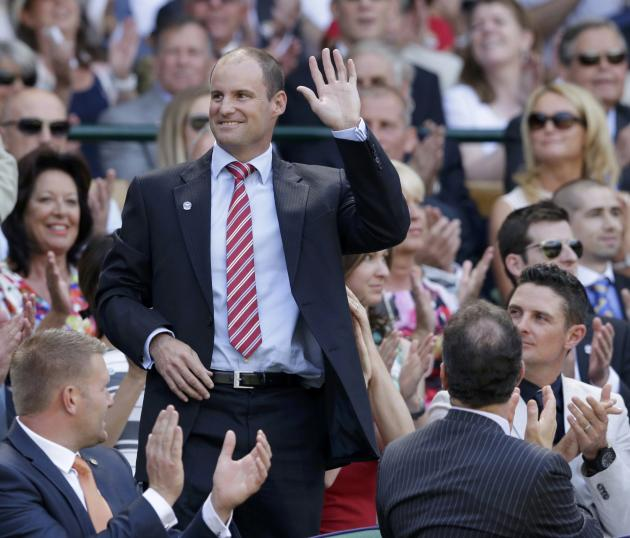 England cricket director Andrew Strauss waves to spectators on Centre Court as he is introduced at the Wimbledon Tennis Championships in London