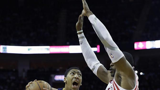 New Orleans Pelicans' Anthony Davis (23) looks to shoot as Houston Rockets' Dwight Howard (12) defends during the fourth quarter of an NBA basketball game on Saturday, Dec. 28, 2013, in Houston. The Rockets won 107-98