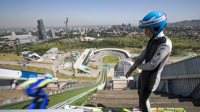 Members of Kazakhstan's national team attend training session at the Sunkar Ski Jumping complex in Almaty