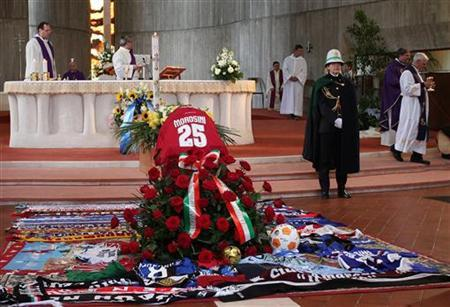 The coffin of Livorno's soccer player Piermario Morosini is seen during his funeral in Bergamo