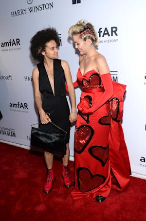 Miley Cyrus, right, attends the 6th Annual amfAR New…