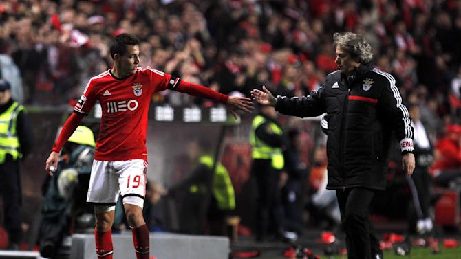 Benfica's Rodrigo, left, from Spain, is congratulated by his coach Jorge Jesus as he leaves the pitch during the Portuguese league soccer match between Benfica and Porto at Benfica's Luz stadium in Lisbon, Sunday, Jan. 12, 2014. Rodrigo scored once in Benfica's 2-0 victory