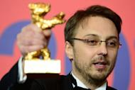"Romanian director Calin Peter Netzer poses with his Golden Bear for the Best Film he received for the movie ""Pozitia Copilului"" (""Child's Pose"") during a press conference following the awards ceremony in Berlin on February 16, 2013"