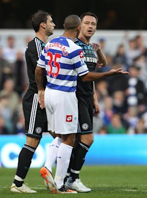 John Terry, right, was punished for a racist slur towards Anton Ferdinand