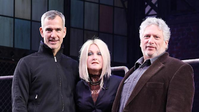 "FILE - This Feb. 28, 2013 photo released by Starpix shows, from left, choreographer Jerry Mitchell, Cyndi Lauper and Harvey Fierstein at the open house for the Upcoming Musical ""Kinky Boots,"" at the Al Hirshfeld Theatre in New York.  The Cyndi Lauper-scored ""Kinky Boots"" has earned a leading 13 Tony Award nominations, Tuesday, April 30, 2013. ""Kinky Boots"" is based on the 2005 British movie about a real-life shoe factory that struggles until it finds new life in fetish footwear. Lauper's songs and a story by Harvey Fierstein have made it a crowd-pleaser. (AP Photo/Starpix, Kristina Bumphrey)"