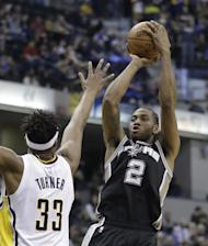 San Antonio Spurs' Kawhi Leonard shoots over Indiana Pacers' Myles Turner during the second half of an NBA basketball game, Monday, Feb. 13, 2017, in Indianapolis. San Antonio defeated Indiana 110-106. (AP Photo/Darron Cummings)