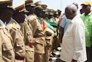 Mozambique President Armando Guebuza greets members of his Frelimo party during a visit to the central-western town of Chimoio, on October 30, 2013