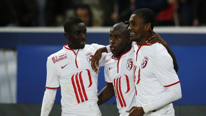 Lille's Mavuba celebrates with teammates after scoring against Paris St Germain during their French Ligue 1 soccer match in Paris