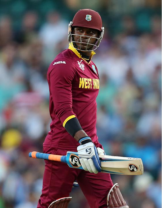 West Indies Marlon Samuels walks from the field after he was dismissed for no score during their Cricket World Cup Pool B match in Sydney, Australia, Friday, Feb. 27, 2015. (AP Photo/Rick Rycroft)