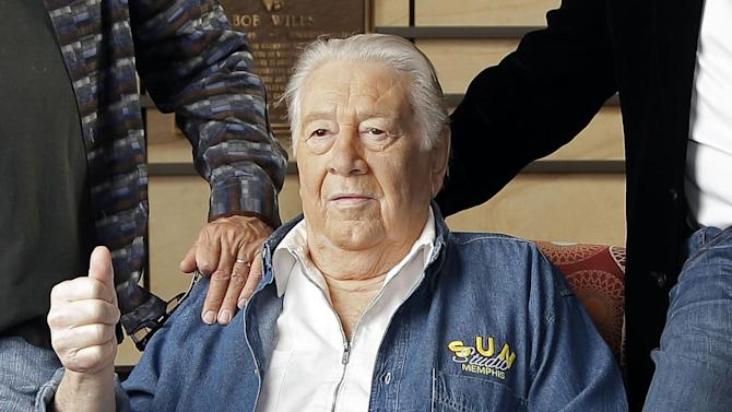 FILE - In this April 10, 2013 file photo, Jack Clement poses for photographers in the Country Music Hall of Fame in Nashville, Tenn. Clement, a producer, engineer, songwriter and beloved figure who helped birth rock 'n' roll and push country music into modern times, died Thursday morning, Aug. 8. He was 82. Clement's career included stops in Memphis at Sun Records where he discovered Jerry Lee Lewis and Nashville where he was a close collaborator of Johnny Cash, Charley Pride and fellow 2013 Country Music Hall of Fame inductee Bobby Bare. (AP Photo/Mark Humphrey, File)