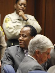 Dr. Conrad Murray turns to the courtroom audience after he was sentenced to four years in county jail for his involuntary manslaughter conviction of pop star Michael Jackson, in Superior Court in Los Angeles, Tuesday, Nov. 29, 2011. (AP Photo/Mario Anzuoni, Pool)
