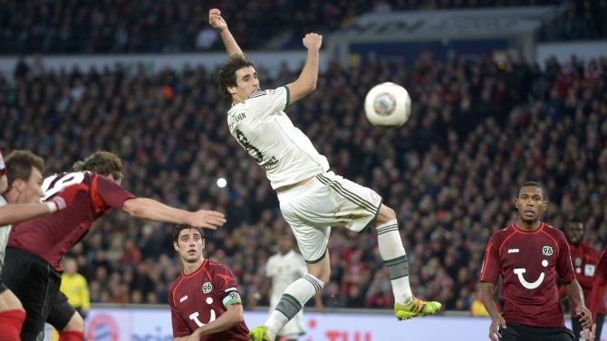Bayern Munich's Martinez tries to score with a header during the German Bundesliga first division soccer match against Hanover 96 in Hanover