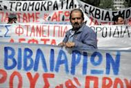 Greek construction workers stand in front of the labour ministry in Athens April 4, during a protest against austerity measures and unemployment in their sector. The European Central Bank looks set to dig its heels in this week and refuse any more easy money for governments as the political resolve to rein in deficits shows signs of crumbling, analysts say