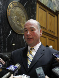 Speaker of the House Brian Bosma, R-Indianapolis, talks about the Democrats proposal for a statewide referendum on the right-to-work legislation during a break in the session at the Statehouse in Indianapolis, Friday, Jan. 13, 2012. (AP Photo/Michael Conroy)