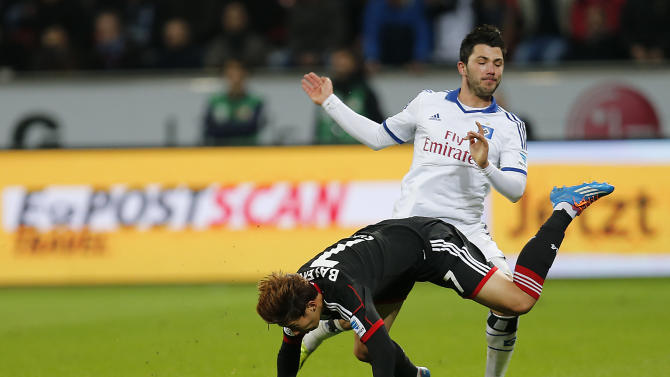 Leverkusen's Son Heung-min  of South Korea, front, is fouled by Hamburg's Tolgay Arslan during the German first division Bundesliga soccer match between Bayer Leverkusen and Hamburg SV in Leverkusen, Germany, Saturday, Nov. 9, 2013