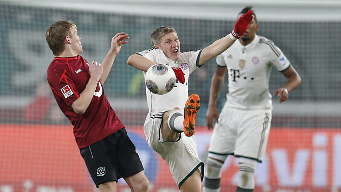 Bayern's Bastian Schweinsteiger, center, and Hannover's Szabolcs Huszti of Hungary challenge for the ball during the German first division Bundesliga soccer match between Hannover 96 and Bayern Munich in Hannover, Germany, Sunday, Feb. 23, 2014