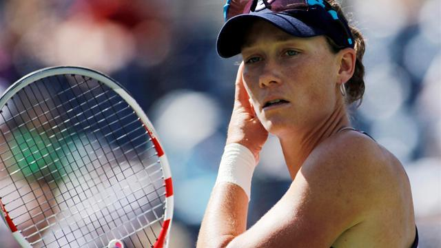 Tennis - Top seed Stosur snatches victory in tense tie-break