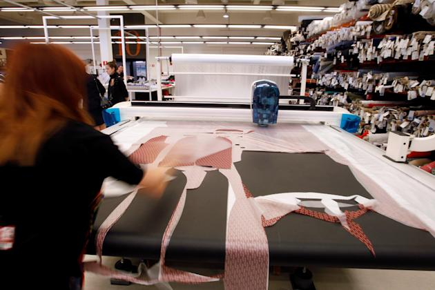 Employee tests fabrics at a clothing factory of Spanish fashion retailer Mango in the industrial town of Palau-solita i Plegamans near Barcelona