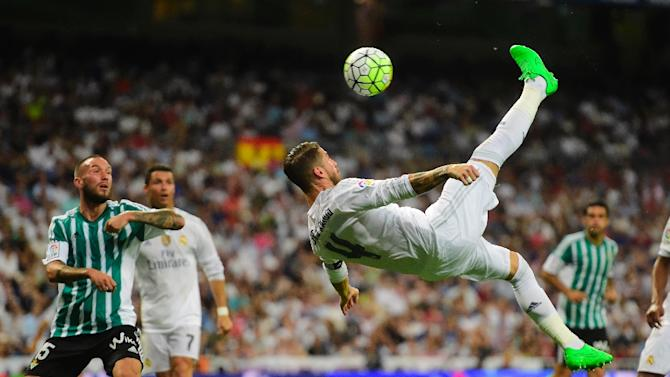 Real Madrid's defender Sergio Ramos performs a bicycle kick during the Spanish league football match Real Madrid CF vs Real Betis Balompie at the Santiago Bernabeu stadium in Madrid on August 29, 2015
