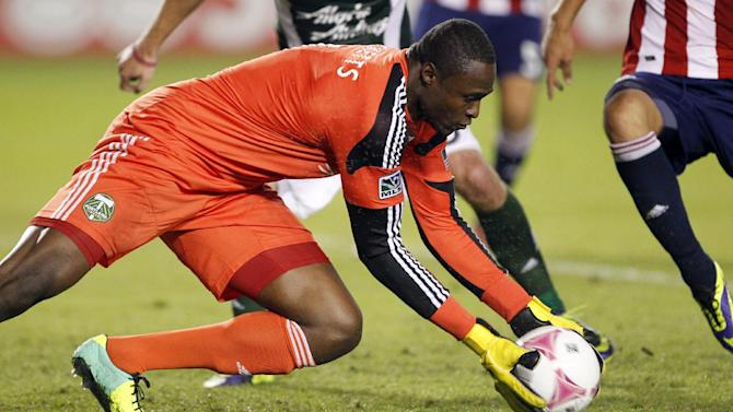 Portland Timbers goalkeeper Donovan Ricketts pulls in a save against Chivas USA during the second half of an MLS soccer match, Saturday, Oct. 26, 2013, in Carson, Calif. Timbers won the match 5-0