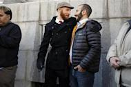 Plaintiffs Derek Kitchen, left, and his partner Moudi Sbeity stand outside the Frank E. Moss federal courthouse in Salt Lake City, Utah, December 4, 2013. REUTERS/Jim Urquhart