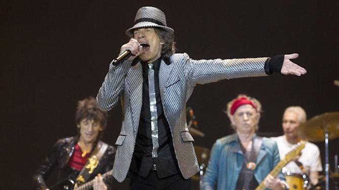 Mick Jagger, front centre,  Ronnie Wood, left, with Keith Richards and Charlie Watts, right, of The Rolling Stones perform at the O2 arena in east London, Sunday, Nov. 25, 2012. The band are playing four gigs to celebrate their 50th anniversary, including two shows at London's O2 and two more in New York. (Photo by Joel Ryan/Invision/AP)