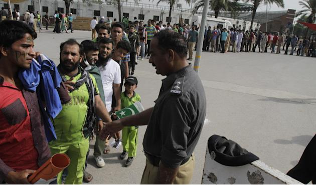 Pakistani cricket fans wait in a queue to enter the Gaddafi Stadium in Lahore, Pakistan, Sunday, May 24, 2015. The Twenty20 matches Friday and Sunday mark a return of international cricket to Pakistan