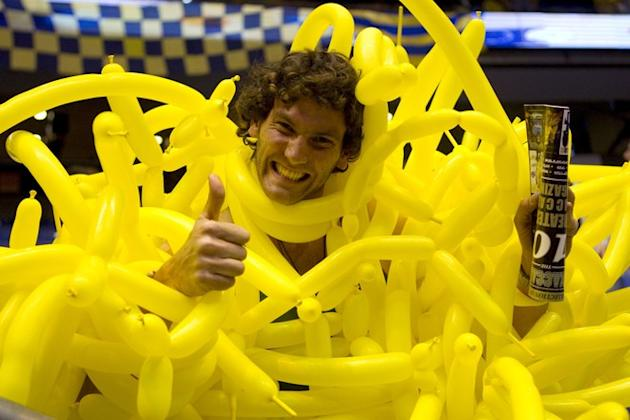 TOPSHOTS A Maccabi Tel Aviv's Fan Surounded By Yellow Balloons Gives The Thumbs Up AFP/Getty Images