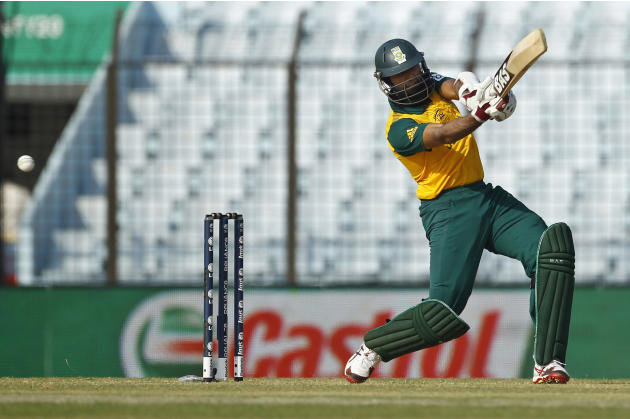 South Africa's Hashim Amla plays a shot during their ICC Twenty20 Cricket World Cup match against New Zealand in Chittagong, Bangladesh, Monday, March 24, 2014. (AP Photo/A.M. Ahad)