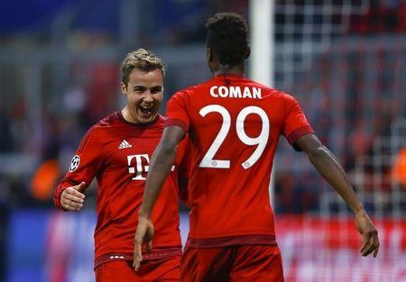 Bayern Munich's Goetze celebrates with Coman after scoring a goal against Dinamo Zagreb during their Champions League Group F soccer match in Munich