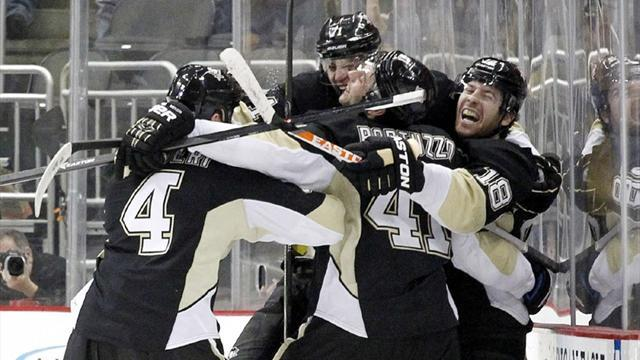 Ice Hockey - OT winner sends Penguins past Senators