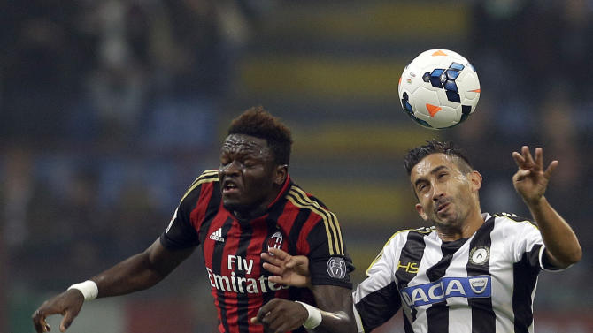 AC Milan's Sulley Muntari, left, and Udinese's Gianfranco Pinzi jump for the ball, during a Serie A soccer match between AC Milan and Udinese, at the San Siro stadium in Milan, Italy, Saturday, Oct. 19, 2013