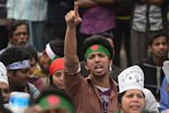 A Bangladeshi youth joins a demonstration demanding the death sentence for war criminals, in Dhaka on February 18, 2013. Police firing rubber bullets shot dead a protester in demonstrations in eastern Bangladesh as a strike called by the largest Islamist party paralysed life across the nation
