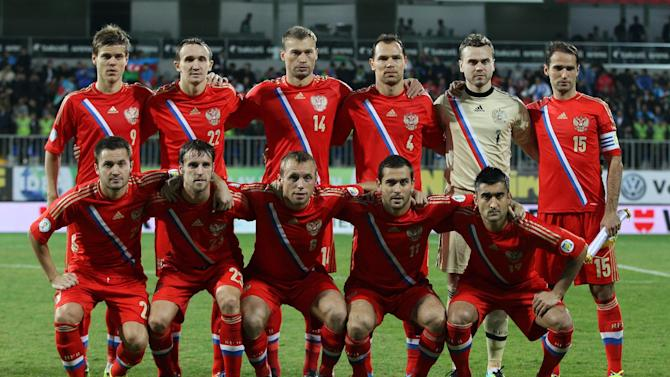 In this Oct. 15, 2013 file photo, Russia national team poses prior to the start the World Cup Group F qualifying soccer match between Russia and Azerbaijan in Baku, Azerbaijan. Foreground from left: Victor Faizulin, Dmitry Kombarov, Denis Glushakov, Alexander Kerzhakov and Alexander Samedov. Background from left: Alexander Kokorin, Alexey Kozlov, Vasili Berezutsky, Sergey Ignashevich, Igor Akinfeev, and Roman Shirokov. The draw for the 2014 World Cup finals takes place Friday Dec. 6, 2013 near Salvador, Brazil. The 32 teams will be drawn into eight groups of four. The top two in each group will progress to the knockout stages. Twelve stadiums in twelve cities will host matches