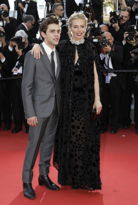 FILE- In this May 17, 2015 file photo, Jury members Xavier Dolan, left, and Sienna Miller pose for photographers upon arrival for the screening of the film Carol at the 68th international film festiva