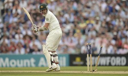 Australia's Siddle is bowled by England's Anderson during the fifth Ashes cricket test match at the Oval cricket ground, London