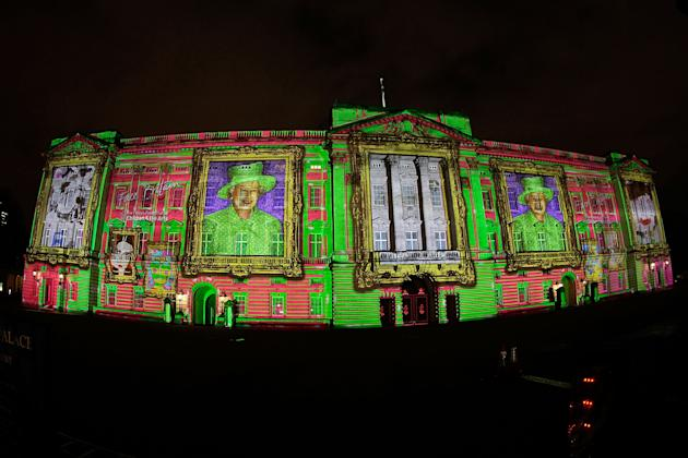 LONDON, ENGLAND - APRIL 19: (EDITORS NOTE - THIS IMAGE WAS CREATED USING A FISHEYE LENS) Face Britain, a light show consisting of over 200,000 self portraits of children, is projected onto Buckingham Palace to form a montage image of Her Majesty the Queen on April 19, 2012 in London, England. The project was created by The Prince's Foundation for Children & the Arts, which enables disadvantaged young people to access and engage with professional arts. (Photo by Matthew Lloyd/Getty Images)