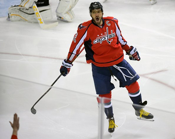 WASHINGTON DC, JANUARY 11: Washington's Alex Ovechkin scores his 1000th career goal in the early first period as the Washington Capitals play the Pittsburgh Penguins at the Verizon Center in Washington DC, January 7, 2016. (Photo by John McDonnell / The Washington Post via Getty Images)