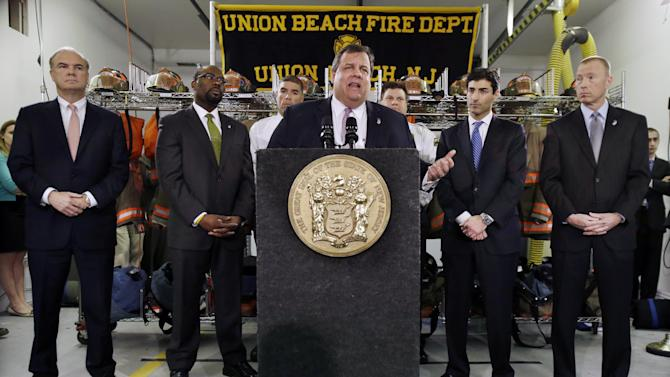 "Bob Martin, left, Commissioner New Jersey Department of Environmental Protection, Richard E. Constable III, second left, Commissioner New Jersey Department of Community Affairs, Marc Ferzan, second right, who manages the state's Superstorm Sandy Recovery efforts, and Ken Kobylowski, right, Commissioner New Jersey Department of  Banking and Insurance look on as Gov. Chris Christie addresses a gathering of residents and others in Union Beach, N.J., Tuesday, Feb. 5, 2013. Christie said Tuesday the National Flood Insurance Program's handling of claims in New Jersey ""has stunk,"" complaining that the program has been far too slow to resolve claims from Superstorm Sandy, with 70 percent of cases unresolved three months after the disaster. (AP Photo/Mel Evans)"